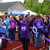 Cancer survivor Jessica Stroia shows her enthusiasm after cutting the ribbon to start Saturday's Relay for life at Shenango High School's Glenn 'Pop' Johnston Stadium.