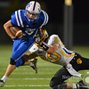 Aaron Beckman/DailyNews  <br /> <br /> Lutheran High's Logan Bussey (9) attempts to breakaway from Shelby-Rising City's Max Hoatson (80) Friday night in Norfolk.