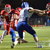 Aaron Beckman/Daily News  <br /> <br /> Norfolk Catholic's Dylan Kautz (1) runs around Columbus Lakeview's Nicholas Dolezal (23) Friday night in Norfolk.