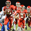 Aaron Beckman/Daily News  <br /> <br /> Norfolk Catholic's Tobi Obatusin runs down the field after a fumble recovery against Columbus Lakeview Friday night in Norfolk.