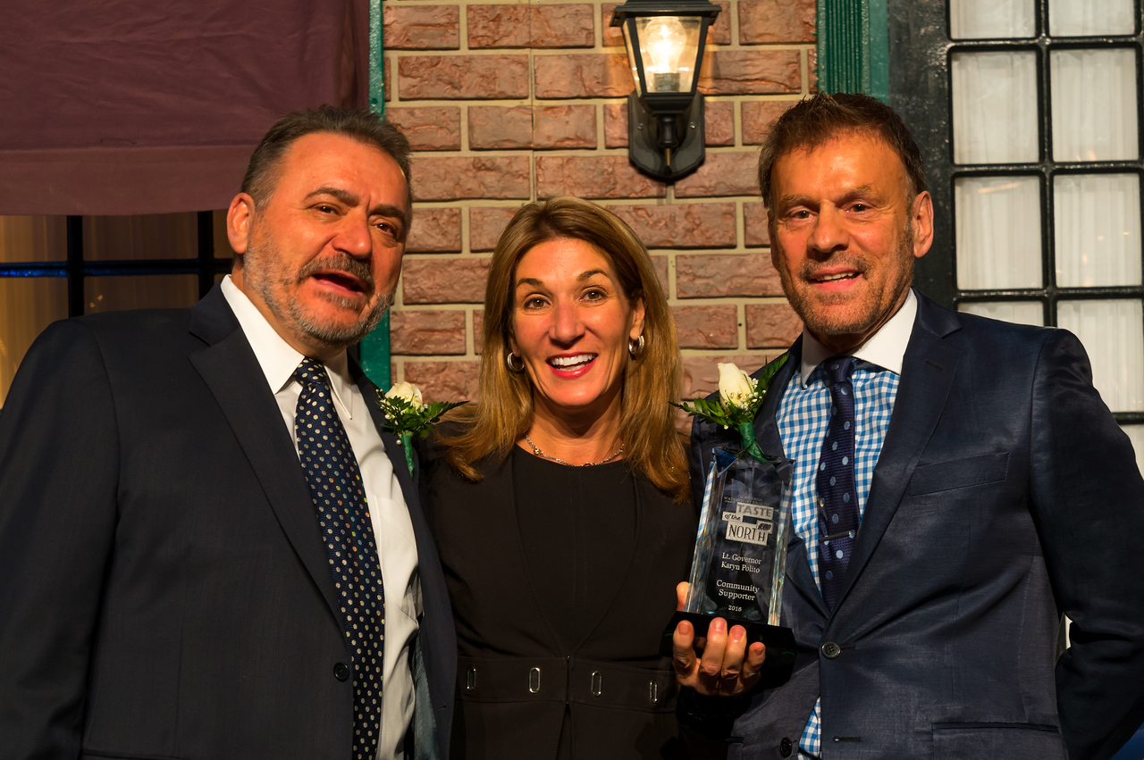 Hosts Donato Frattaroli and James Luisi present the Community award to Lt. Governor Karyn Polito