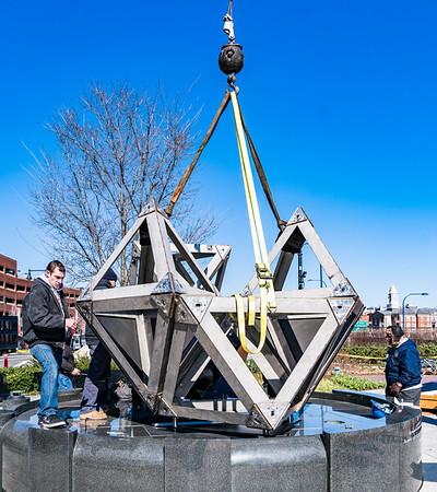 A crane places the final piece.