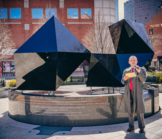 James Kalustian speaks in front of the Armenian Heritage memorial