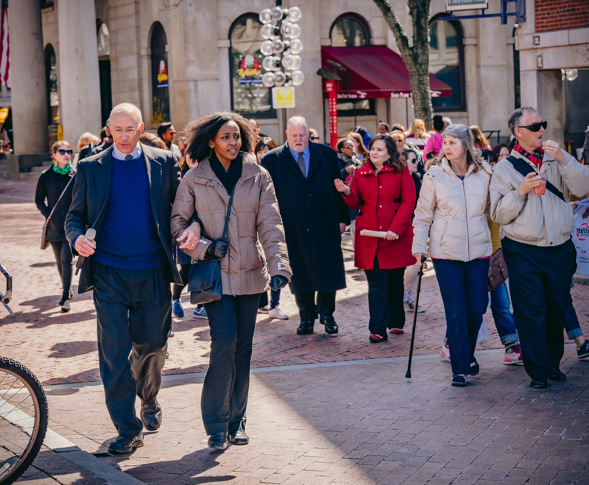 Walkers make their way through Quincy Market