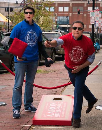 East Boston State Rep Adrian Madaro and City Councilor Sal LaMattina compete at the Cornhole Classic