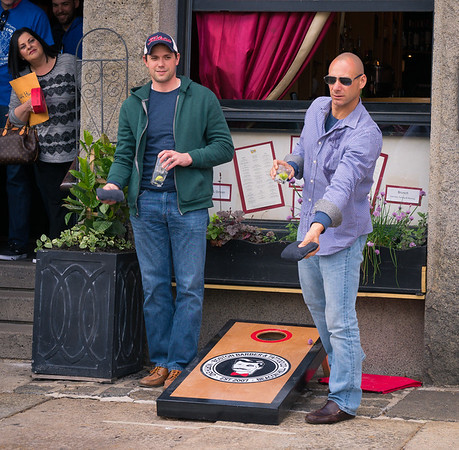 Tossing bean bags at the 1st North End Cornhole Classic