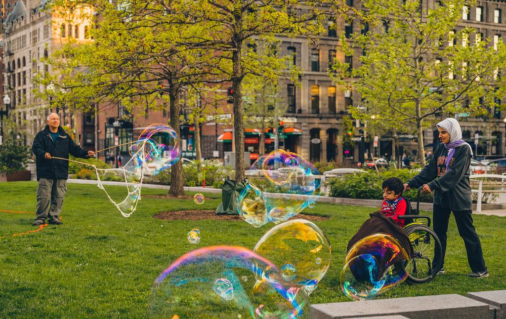A boy enjoys the bubble demonstration