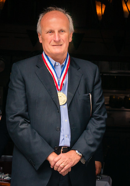 Frank DePasquale wearing the Five Star Diamond Award Medal