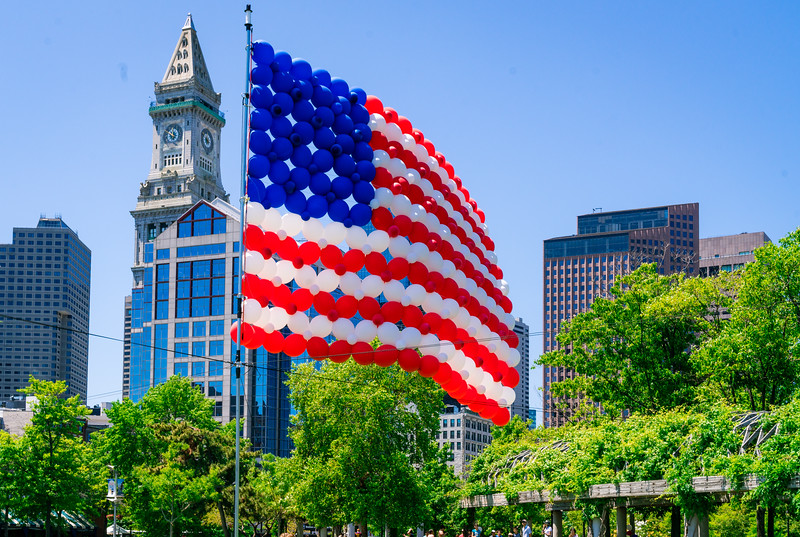 Monumental balloon flag waves at Christopher Columbus Park