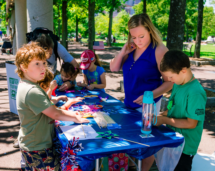 NEMPAC's arts table at the Independence Day celebration