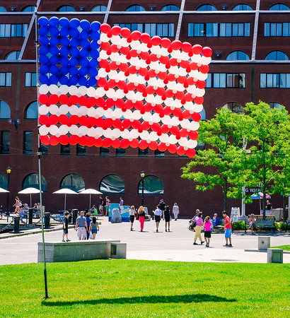 US Flag made out of balloons waves in the park