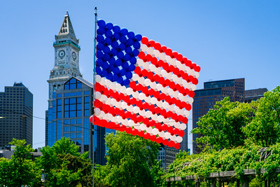 US Flag over Christopher Columbus Park with Custom House and skyline
