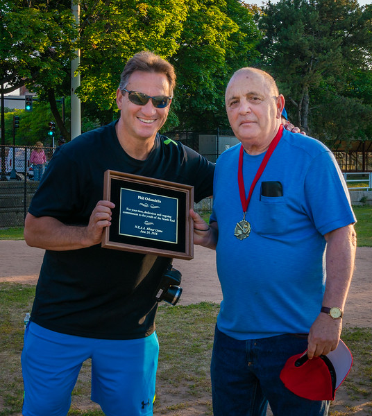 NEAA Commissioner Ralph Martignetti presents plaque to Phil Orlandella
