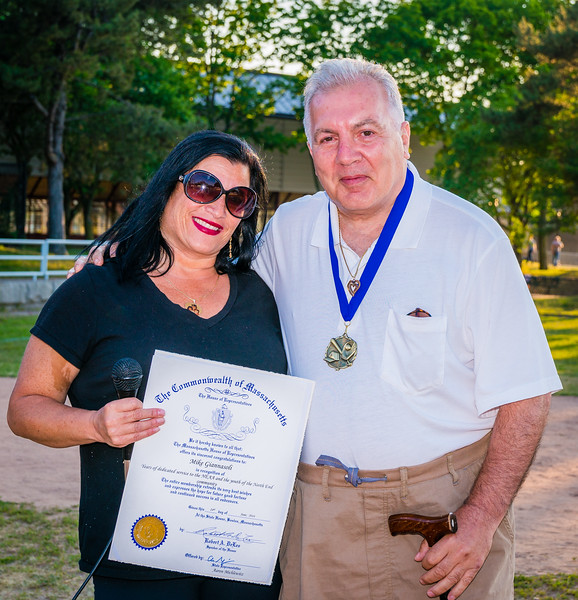 From State Rep. Aaron Michlewitz's office, Karen D'Amico presents  an official citation to Mike Giannasoli