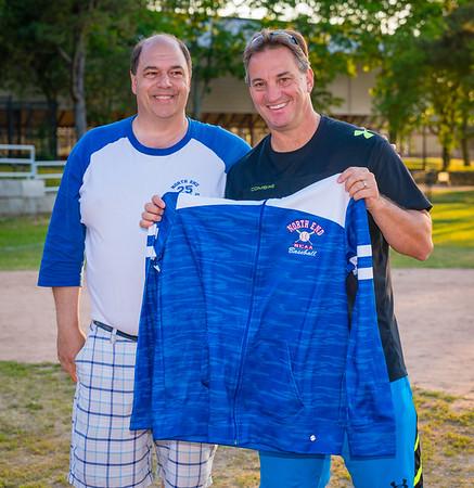 NEAA Coordinator john Romano presents sweatshirt to Commish Ralph Martignetti