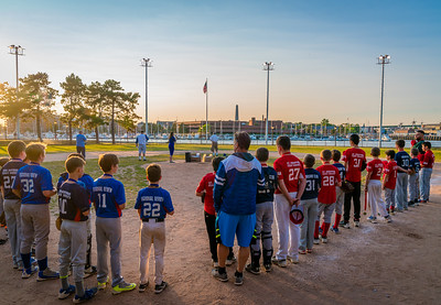 All-Star Teams line up for the National Anthem at Langone Park