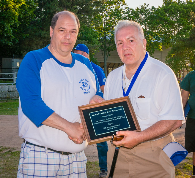 "NEAA Coordinator john Romano presents plaque to Mikey ""Fud"" Giannasoli"
