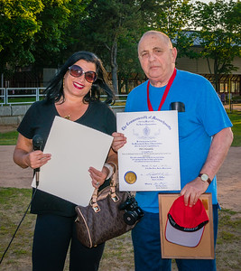 From State Rep. Aaron Michlewitz's office, Karen D'Amico presents  an official citation to Phil Orlandella
