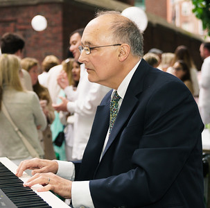 Tom Schiavoni plays piano at the Summer Soiree event