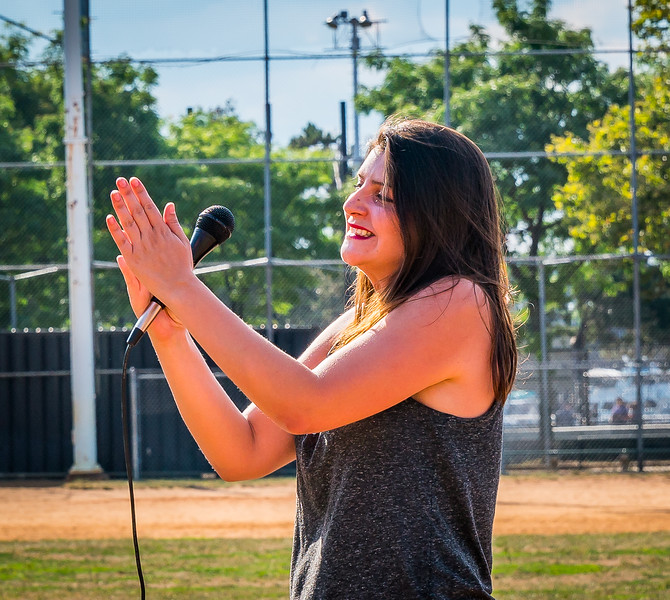 """NEMPAC Instructor applauds the crowd sing-along of """"Take Me Out to the Ball Game"""""""