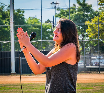 "NEMPAC Instructor applauds the crowd sing-along of ""Take Me Out to the Ball Game"""