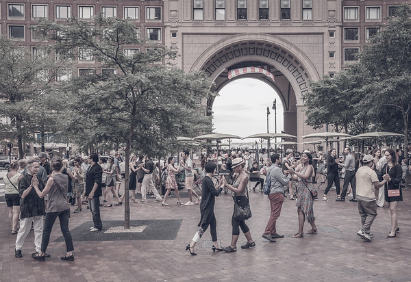 The tango event is set across from Rowes Wharf with its iconic arch