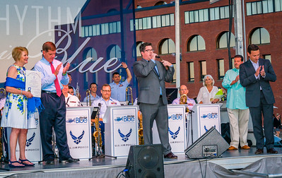 Parks Commissioner Chris Cook speaks about the FOCCP in front of the U.S. Air Force Rhythm in Blue Jazz Band