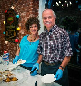 Laura and Jim serve food at the NEWRA Summer Party