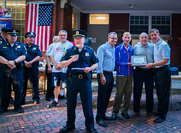 Captain Ken Fong speaks for the Community Service Award to Phil Orlandella