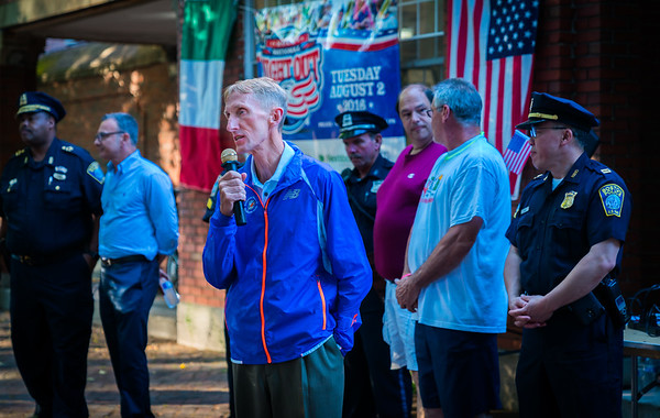 Boston Police Commissioner William Evans speaks on the Prado at National Night Out in the North End