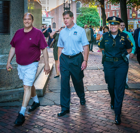Boston Mayor Marty Walsh walks on the Prado with NEAD President John Romano and Boston Police