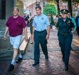 Boston Mayor Marty Walsh walks on the Prado with NEAD President John Romano and Boston Police