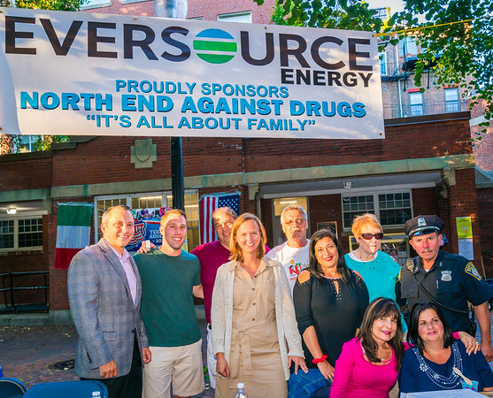 North End Against Drugs Board Members (L-R) State Rep. Aaron Michlewitz, NEWNC President John Pregmon, NEAD President John Romano, Ann Fitzgerald, George Hayada, Karen D'Amico, NEW Health Mary Wright and BPD Officer Teddy Boyle with (stting) Kathy Carangelo and Olivia Scimeca