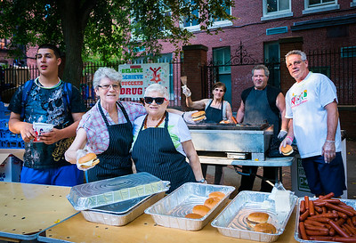 The Workers grill up burgers and hot dogs for NEAD's National Night Out on the Prado