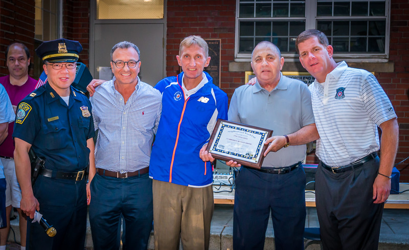 Phil Orlandella (2nd from right) receives Community Service Award, shown here with Mayor Marty Walsh (right), Boston Police Commissioner William Evans (center), BPD Area A-! Captain Ken Fong (left) and District 1 City Councilor Sal LaMattina