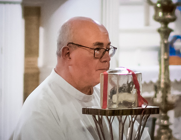 Fr. Antonio Nardoianni of St. Leonard Parish holds the heart relic of St. Padre Pio
