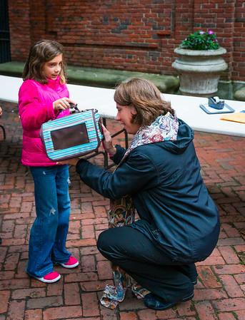 Rev. Ellie Terry blesses Talia's guinea pig