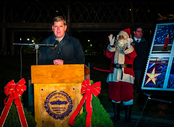 Boston Mayor Martin J. Walsh speaks to the crowd at the trellis lighting