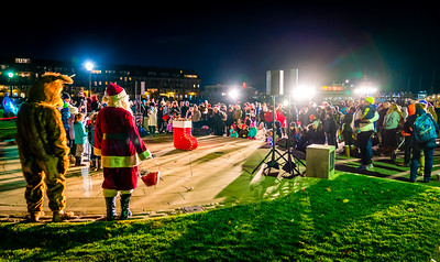 Holiday celebration crowd at Christopher Columbus Park for the annual trellis lighting