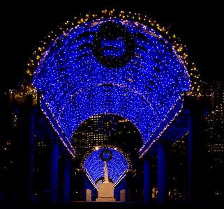Under the blue light trellis toward the Columbus statue
