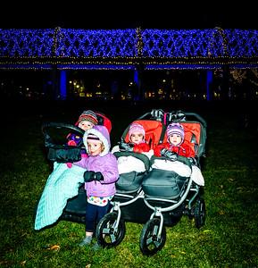 Bundled kids at the trellis lighting