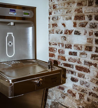 Old brick walls meld with modern features such as this water fountain