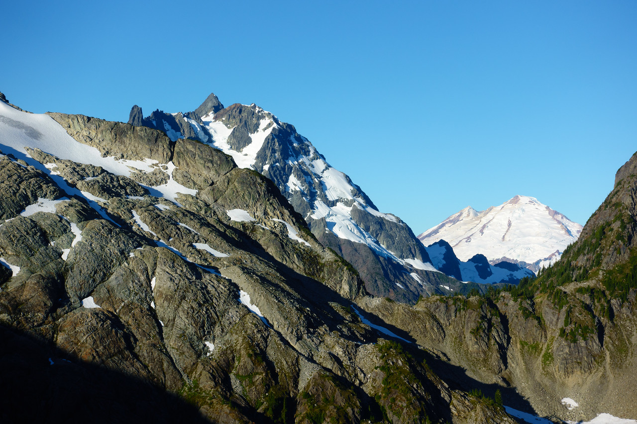 Views of Shuksan and Mount Baker from the saddle between pt. 5930 and Ruth Mountain.