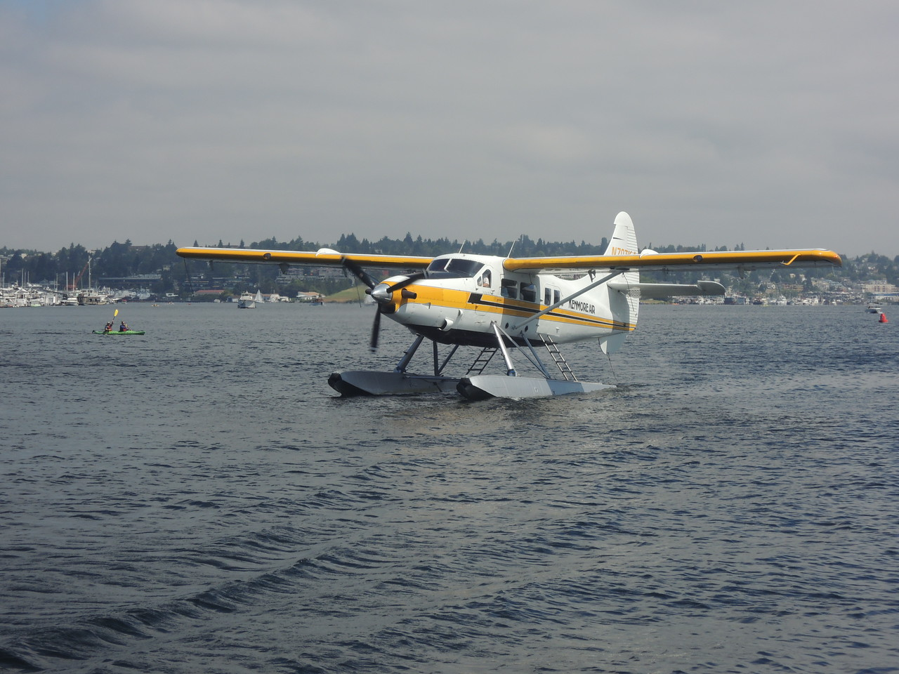 Time on Lake Union is very incomplete without some seaplanes going by.  As this one passed the dock I was standing on, the young boy and his dad at the end of the dock waved and the pilots and every passenger waved back!