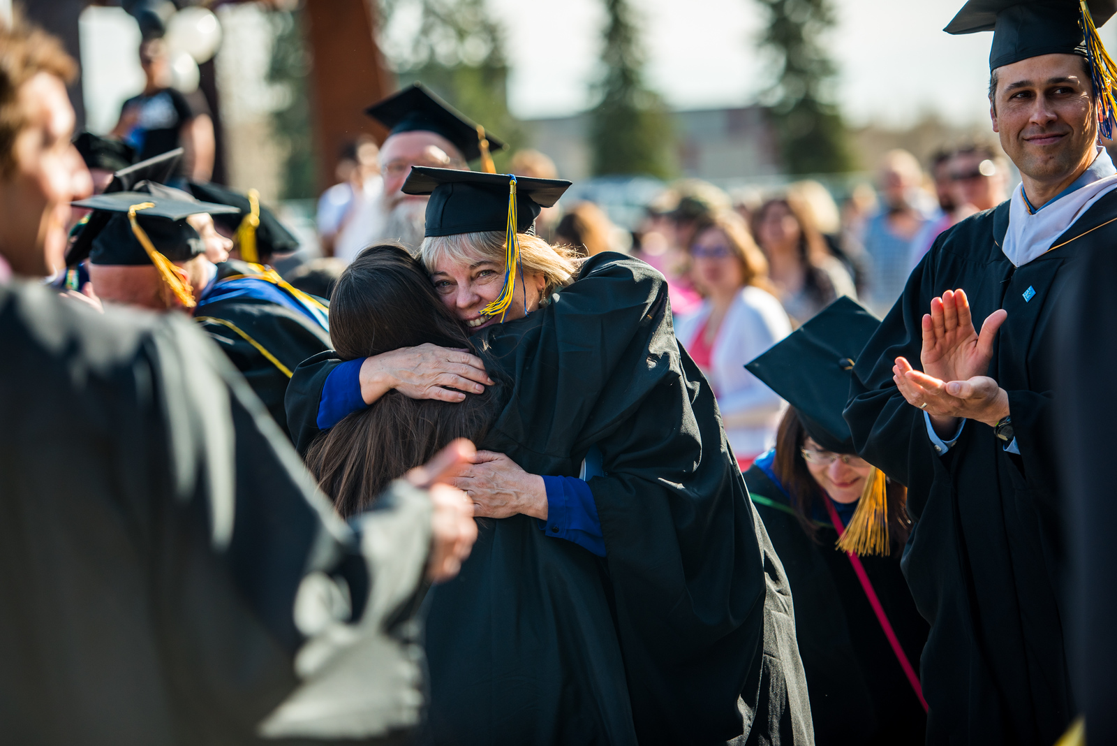 UAF Spanish instructor Kim Aragon-Stewart hugs a student following Commencement 2017.
