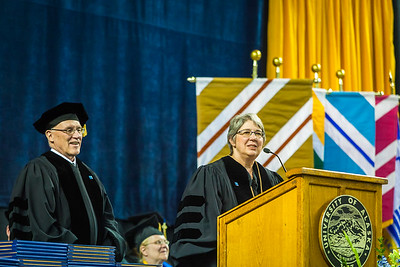 Karen Purdue and Charles Bettisworth provide remarks during the 2017 commencement address at the Carlson Center.