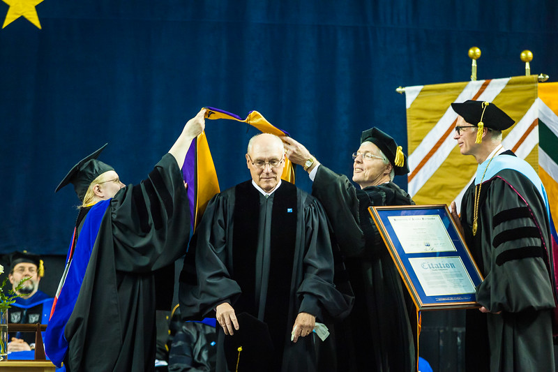 Charles Bettisworth receives an honorary doctor of laws degree at the commencement ceremony May 6, 2017, at the Carlson Center.