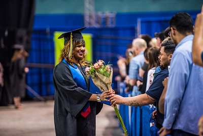 CTC student Tressica Chambers receives flowers after walking across the stage during Commencement 2017.