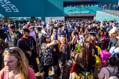 Graduates with their friends and family gather outside the Carlson Center after the 2017 commencement ceremony Saturday, May 6.
