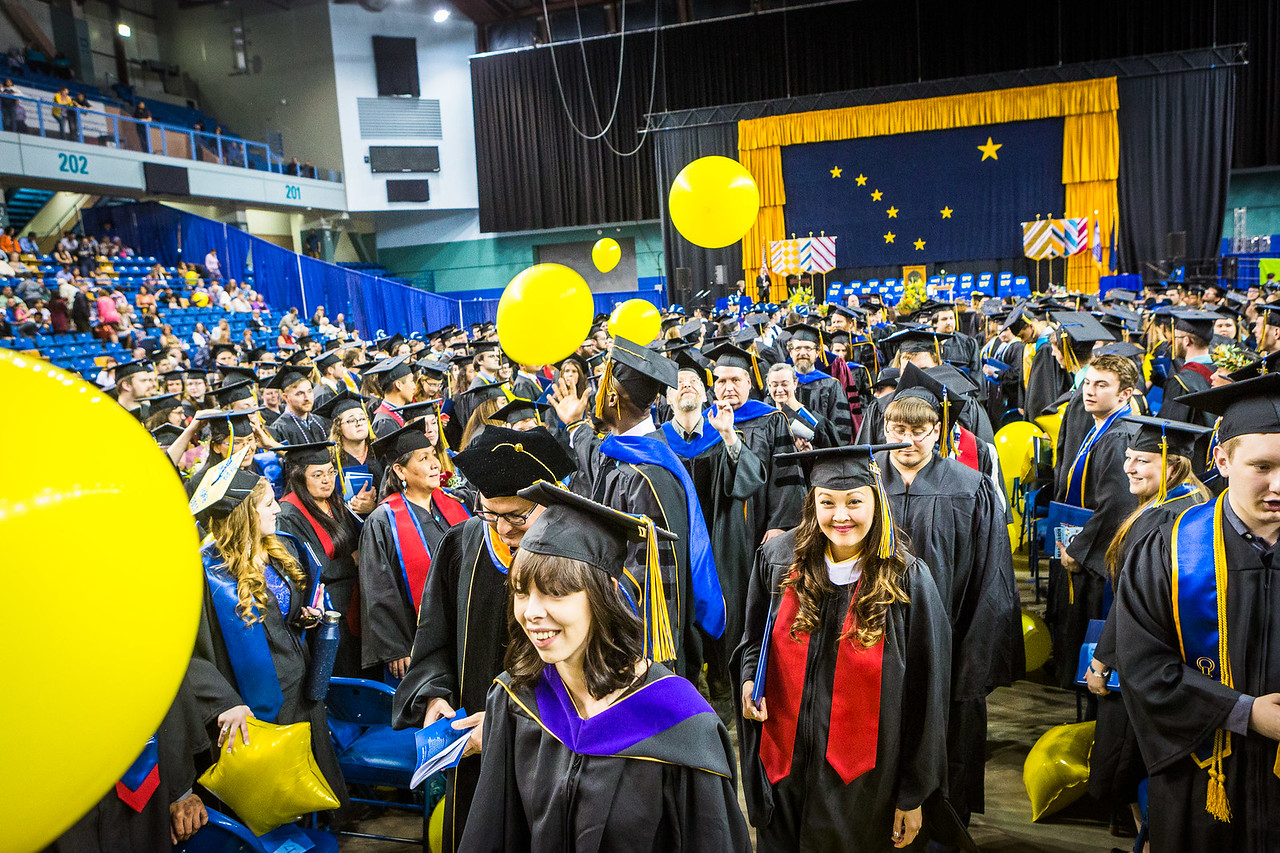 Graduates file out of the main floor of the Carlson Center as the UAF Percussion Group, Ensemble 64.8, leads the recessional music during the 2017 Commencement Ceremony.